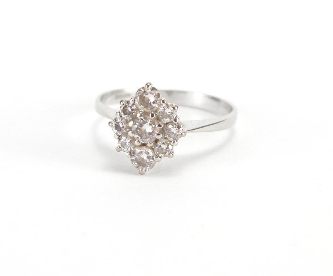 18ct white gold diamond cluster ring, size P, approximate weight 2.7g Further condition reports