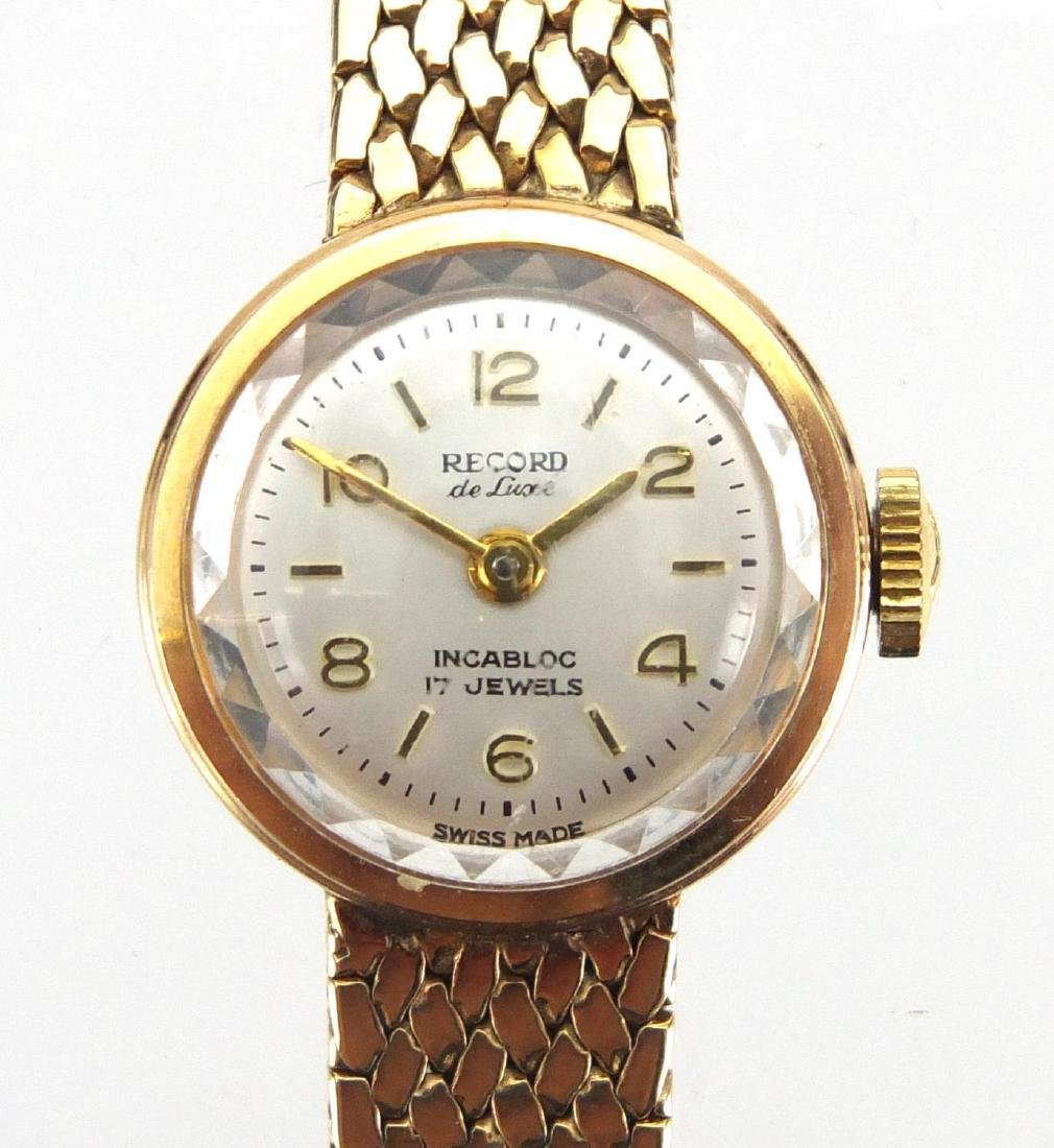 Ladies 9ct gold Record wristwatch with 9ct gold strap, boxed, approximate weight 25.2g Further