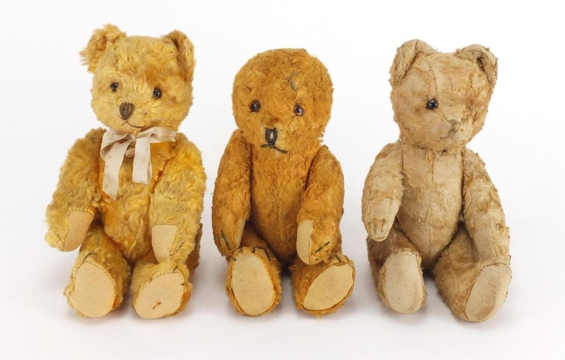 Three vintage golden teddy bear's each with jointed limbs and beaded eyes, the largest 22cm high