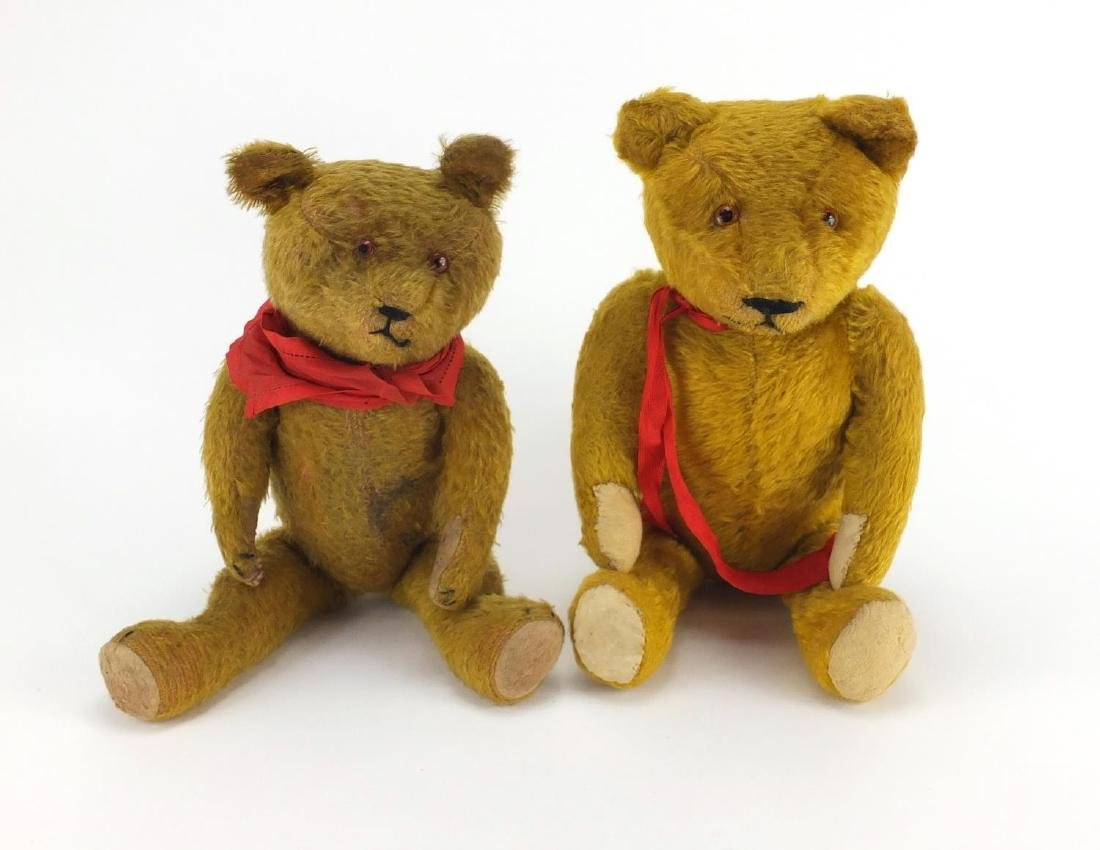 Two vintage golden straw filled teddy bear's with jointed limbs and beaded eyes, one with growler,