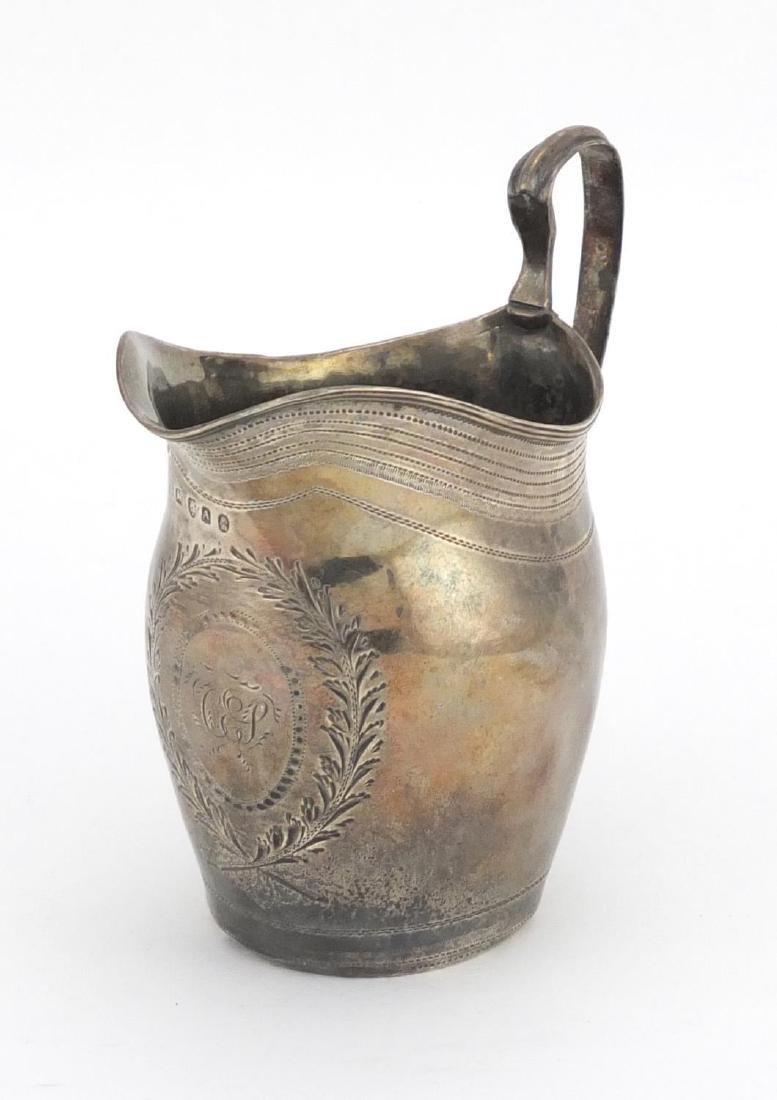 Georgian silver cream jug, engraved with a wreath, indistinct makers mark London 1796, 10.5cm