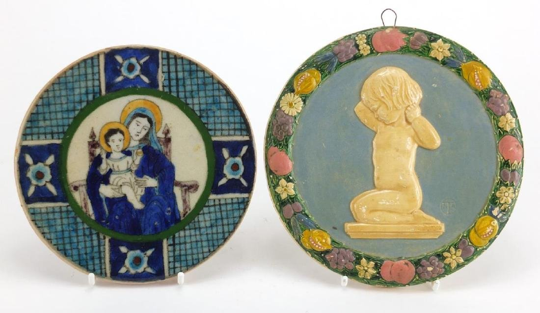 Circular stoneware wall plaque hand painted with Madonna and Child together with a plaster