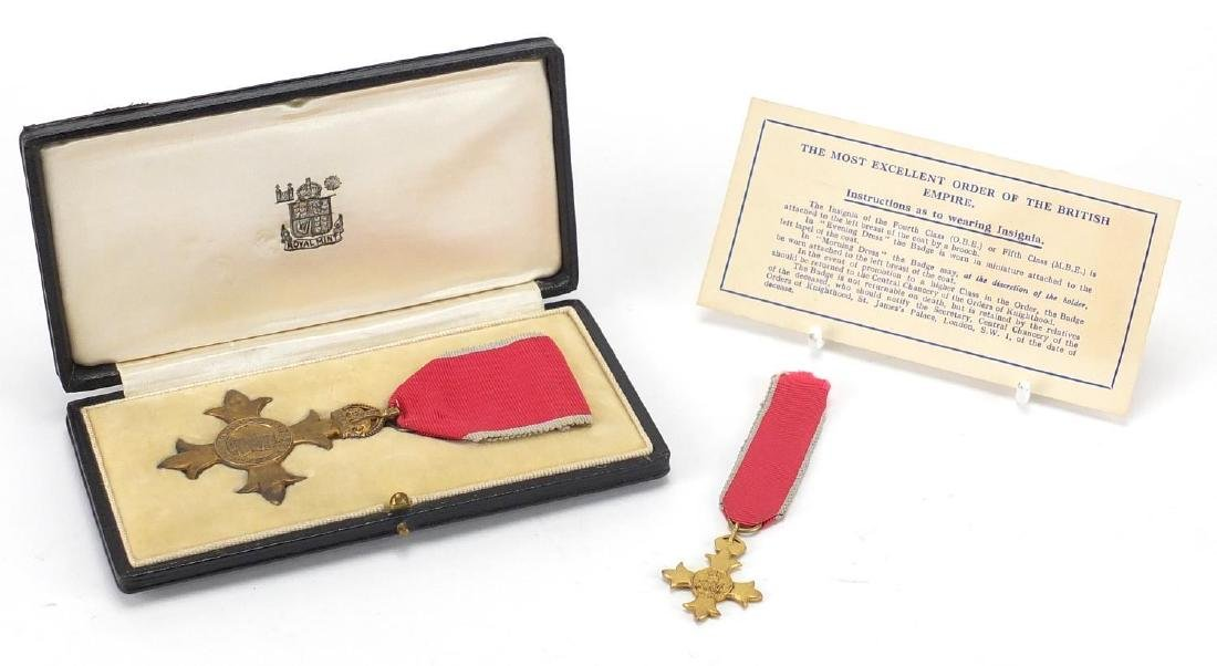 Silver gilt OBE with dress medal, housed in a fitted tooled leather case Further condition reports