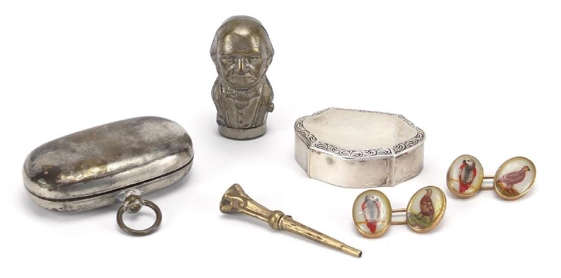Miscellaneous objects including an 800 grade silver pill box, double sovereign case and figural
