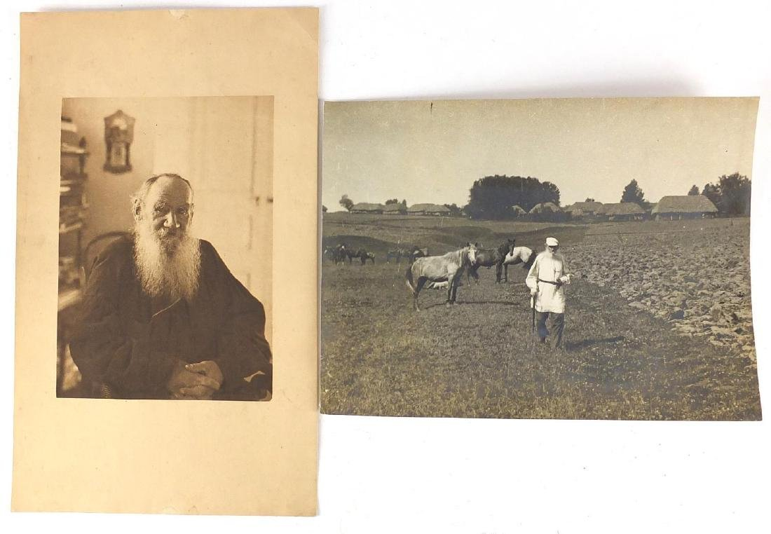 Black and white photograph of Leo Tolstoy, Russian writer in a field with cattle and a portrait of