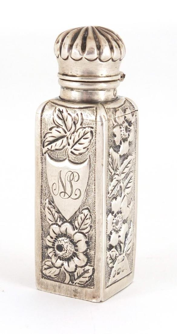 Victorian silver scent bottle embossed with flowers, hinged lid and glass stopper, A.W.P