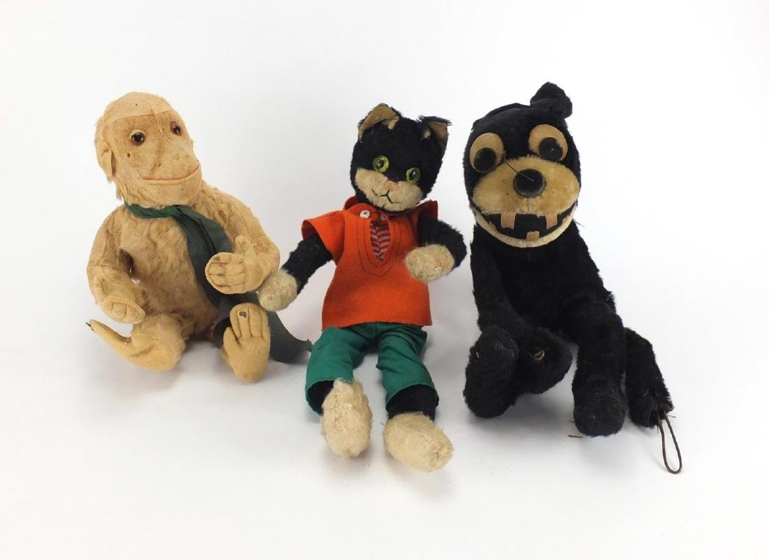 Three vintage animals including a straw filled Felix the cat, the largest 41cm high Further