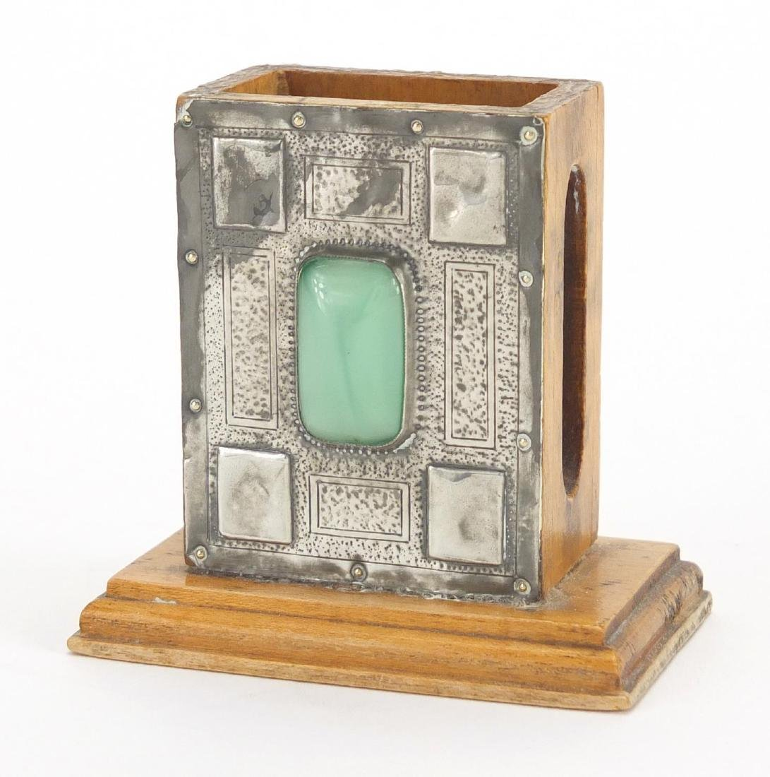 Arts & Crafts matchbox holder, the pewter front inset with cabochon, 7cm high Further condition
