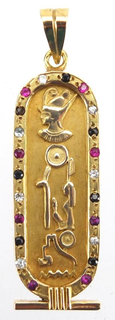 Egyptian gold pendant decorated in relief with hieroglyphics and set with colourful stones, 5.5cm in