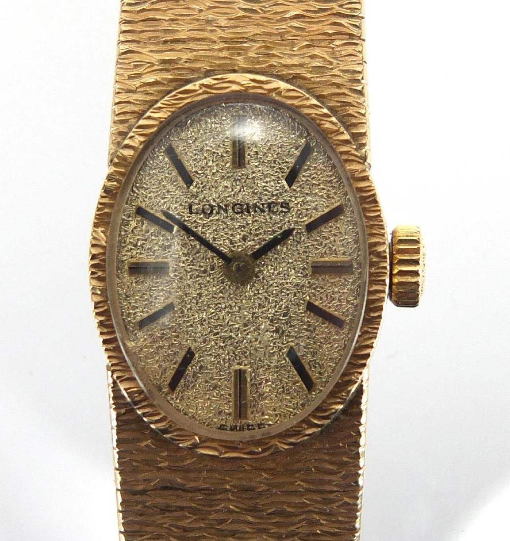 Ladies 9ct gold Longines wristwatch with 9ct gold strap, approximate weight 31.8g Further