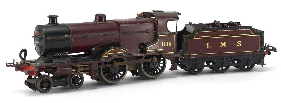 Hornby O gauge clockwork LMS locomotive and tender, numbered 1185 Further condition reports can be