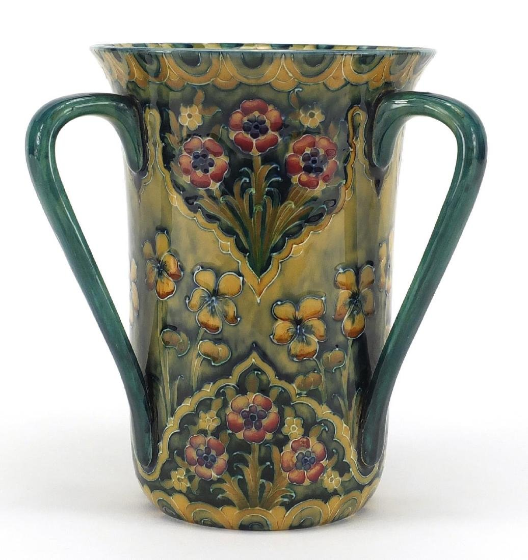 Macintyre Moorcroft pottery tyg, hand painted and tube lined with flowers, factory marks and
