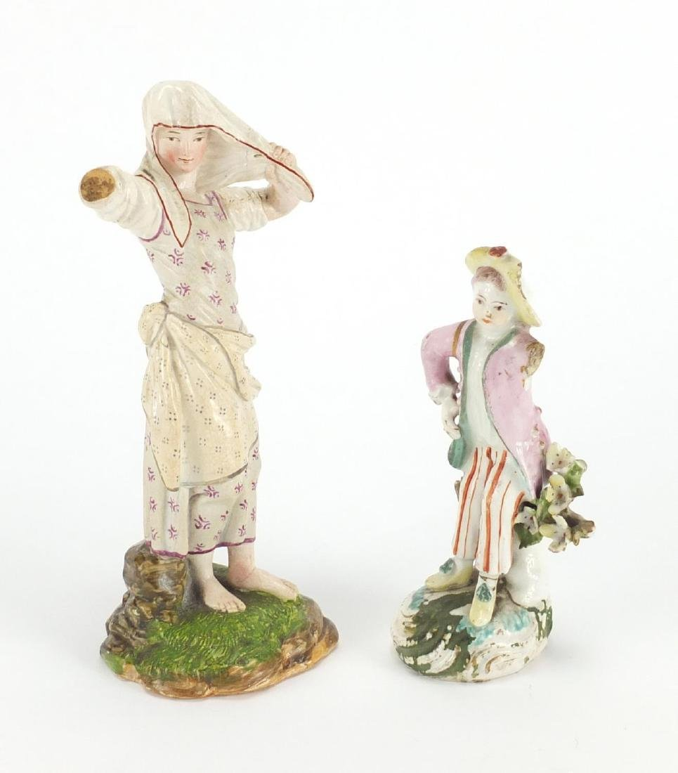 Two 18th century hand painted porcelain figures, one with paper label inscribed Dahl-Höchst to the