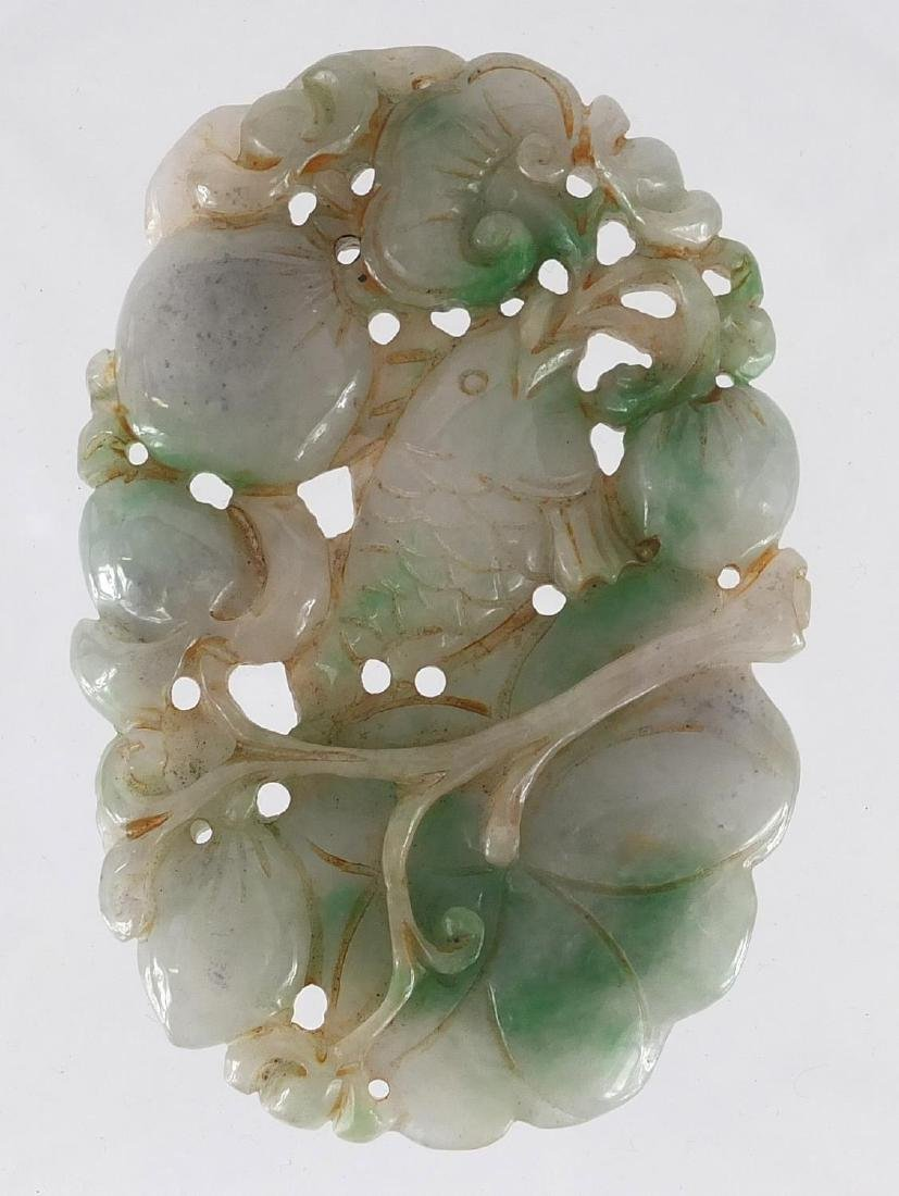 Chinese white and green jade pendant, carved and pierced with a fish and fruit, 9.5cm high Further