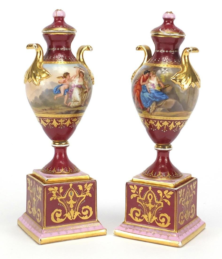 Pair of 19th century Vienna porcelain urn vases and covers, each hand painted with classical figures