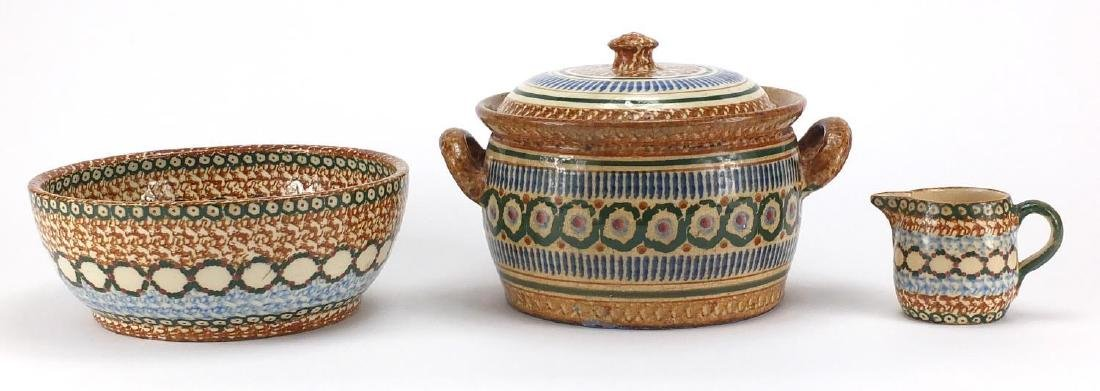 19th century sponge ware comprising a lidded pot with twin handles, jug and bowl, the largest 24cm