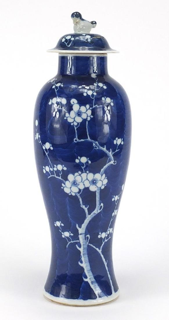 Chinese blue and white porcelain baluster vase and cover, hand painted with Prunus flowers, blue