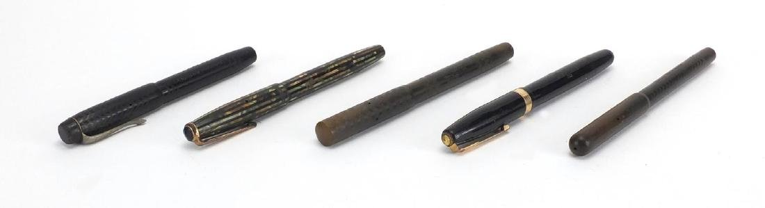 Five vintage fountain pens including green and brown Parker Duofold, Waterman's 515, The Swan pen