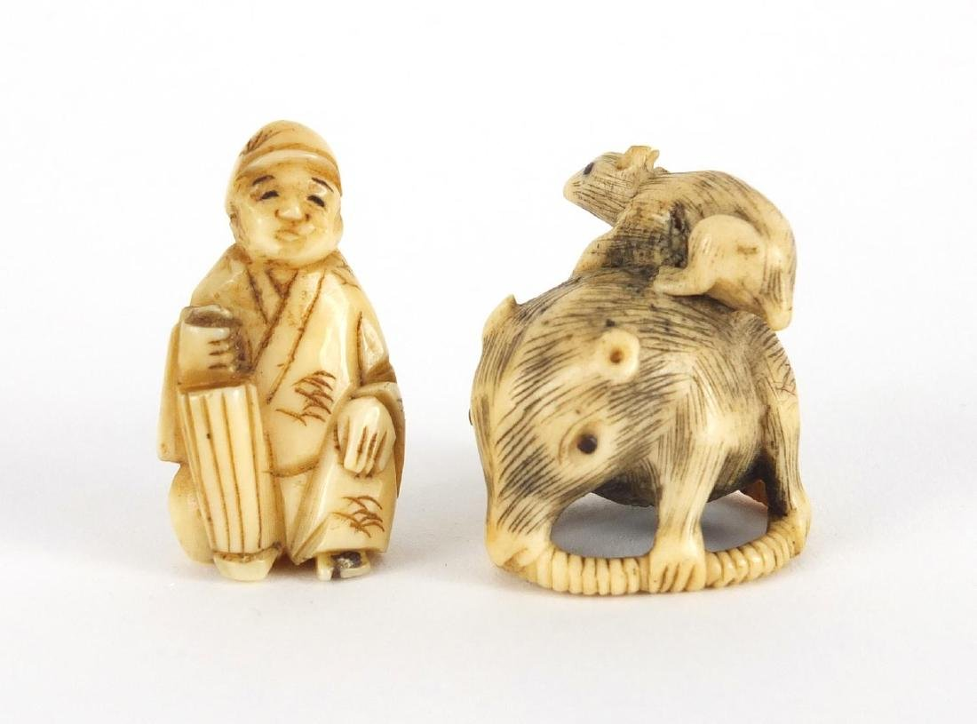 Two Japanese carved Netsuke's, one of a seated figure, the largest 3cm high Further condition