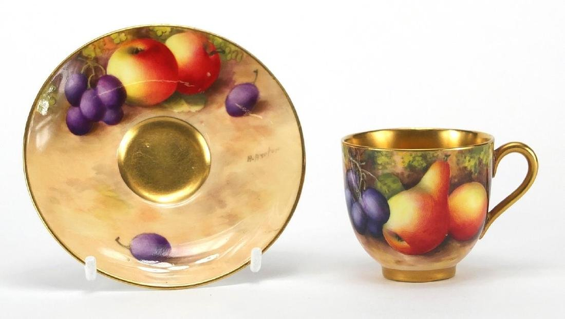 Royal Worcester porcelain cup and saucer, hand painted with fruit by Harry Aynton, the cup