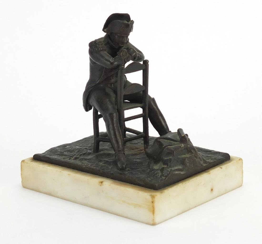19th century bronze study of Napoleon reading plans of The Battle of Waterloo, raised on a white
