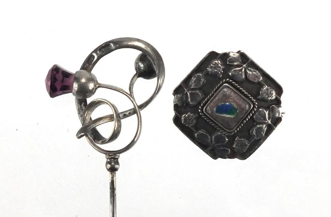 Arts & Crafts silver and enamel brooch and hat pin, both by Charles Horner, the hat pin set with