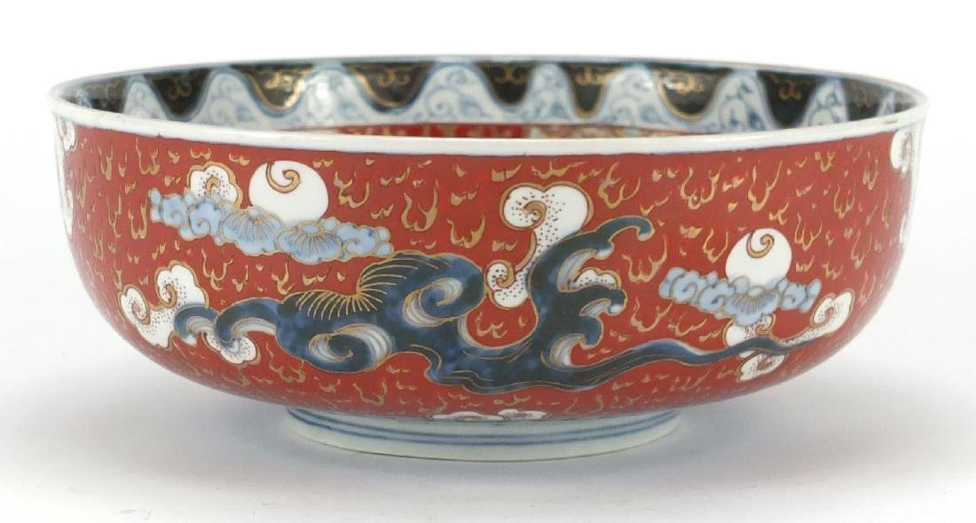Japanese Imari porcelain bowl, hand painted with Phoenixes and dragons amongst clouds, character