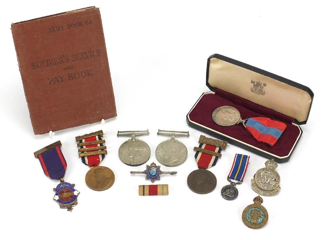 Miscellaneous Militaria including Faithful Service medal awarded to CYRIL THOMAS STEVENS, soldiers