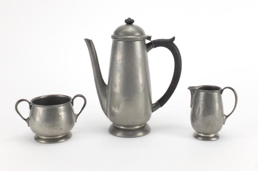 Three piece Tudric pewter tea set Liberty & Co comprising coffee pot, milk jug and sugar bowl,