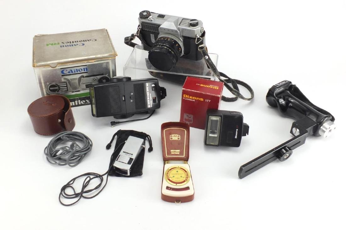 Canonflex RM camera with Super-Canon lense and accessories including a Minox monocular, the camera