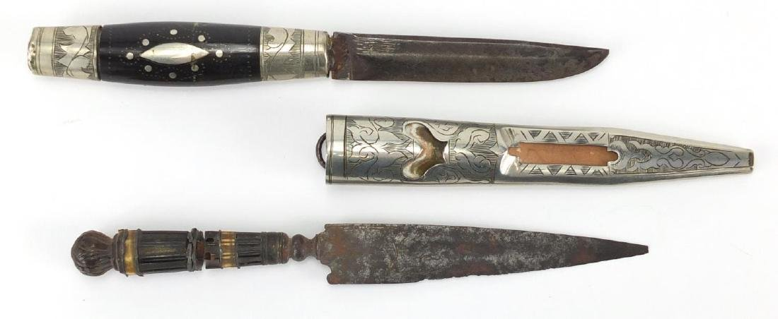 Two antique hunting knives, one with horn handle and sheath, one with engraved steel blade, the