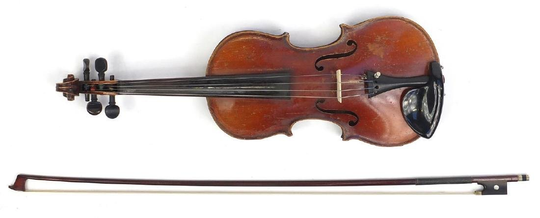 Old wooden violin with scrolled neck, bow and fitted carrying case, the violin bearing a German