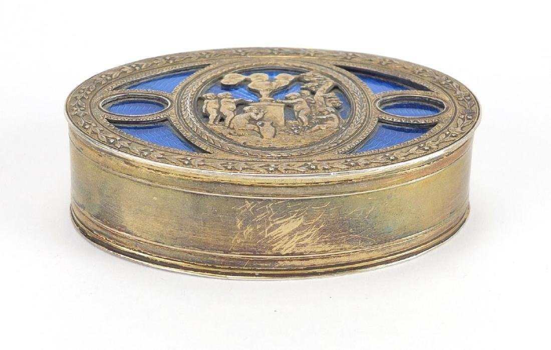 Oval 800 grade silver box, the hinged lid with blue guilloche enamel and decorated with cherubs, 8cm