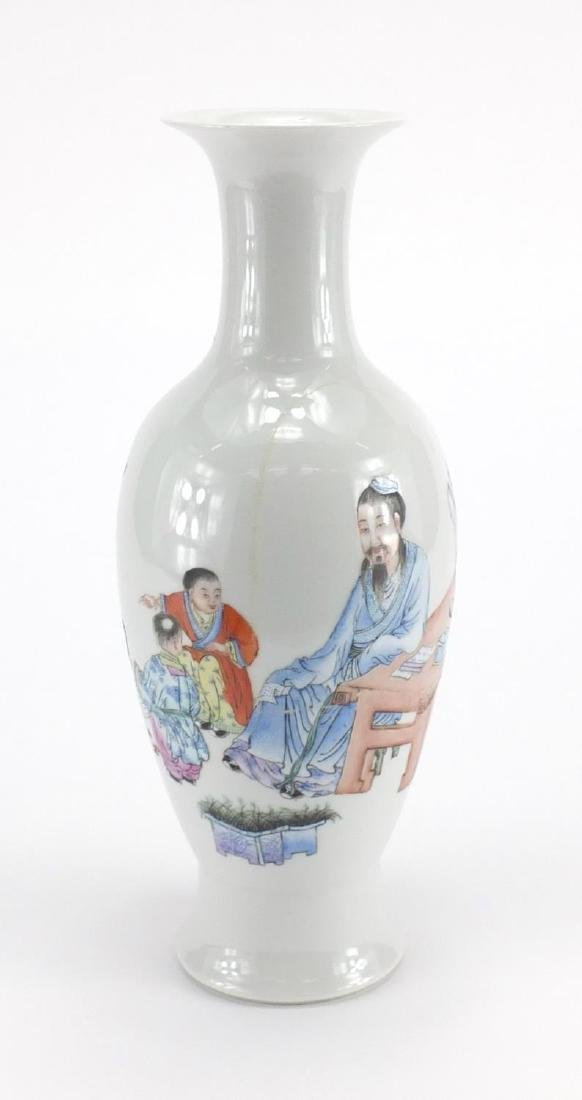 Chinese porcelain baluster vase, hand painted in the famille rose palette with a an elder and two