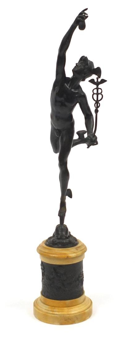 After Giambologna, large patinated bronze study of Mercury, raised on a circular Siena marble column