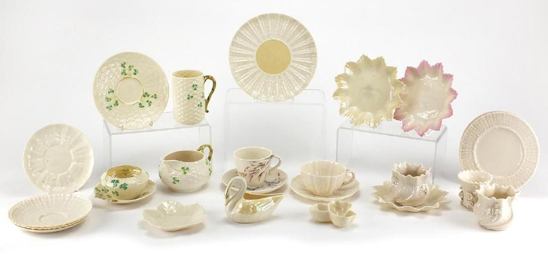 Collection of Belleek porcelain, some early examples including cups, saucers, jug and vases, the