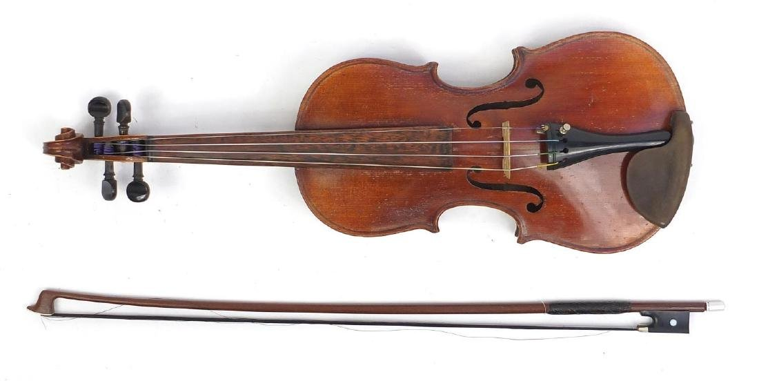 Old wooden violin with scrolled neck, bow and fitted wooden carrying case, the violin bearing a