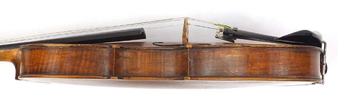Old wooden violin with one piece back and scrolled neck, together with two unnamed violin bows and - 7