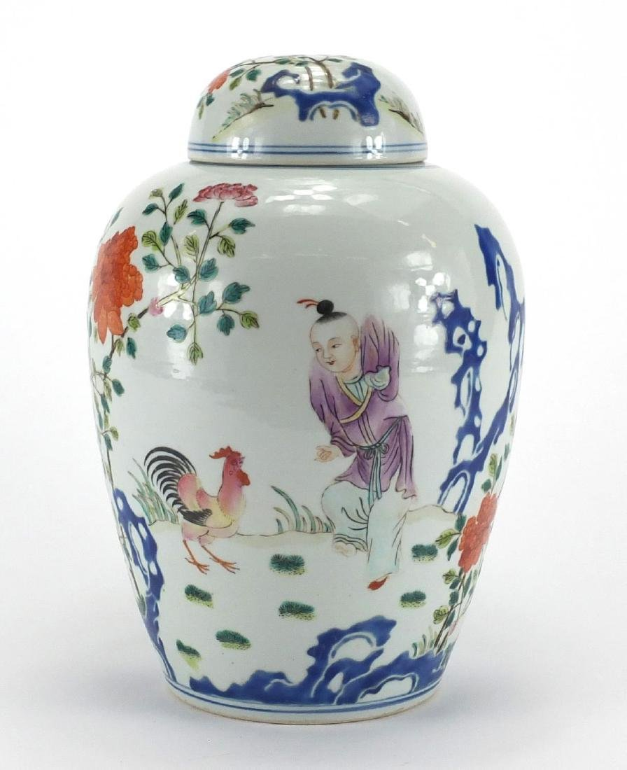 Chinese porcelain jar and cover hand painted in the famille rose palette, with a figure playing with
