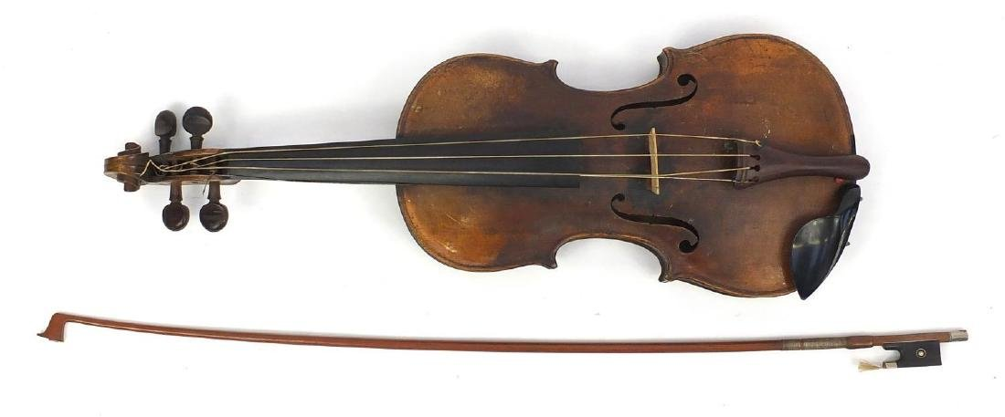 Old wooden violin with one piece back, bow and fitted carrying case, the violin bearing a Renia