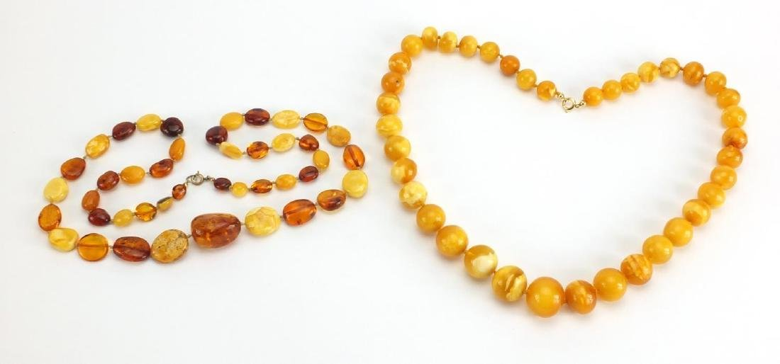 Two butterscotch amber coloured bead necklaces, the largest 70cm in length, approximate weight 111.