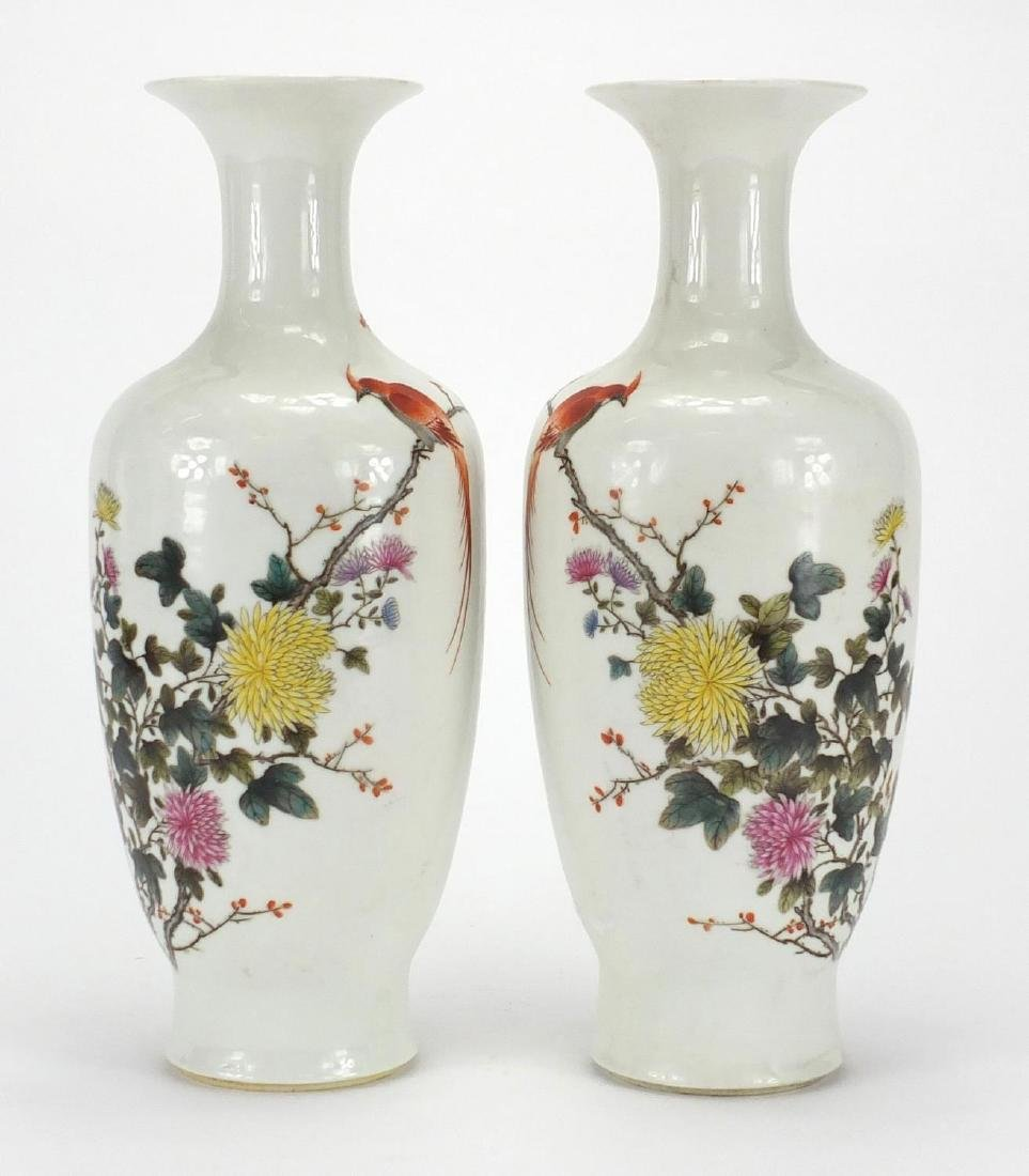 Pair of Chinese porcelain baluster vases, hand painted in the famille rose palette with birds of