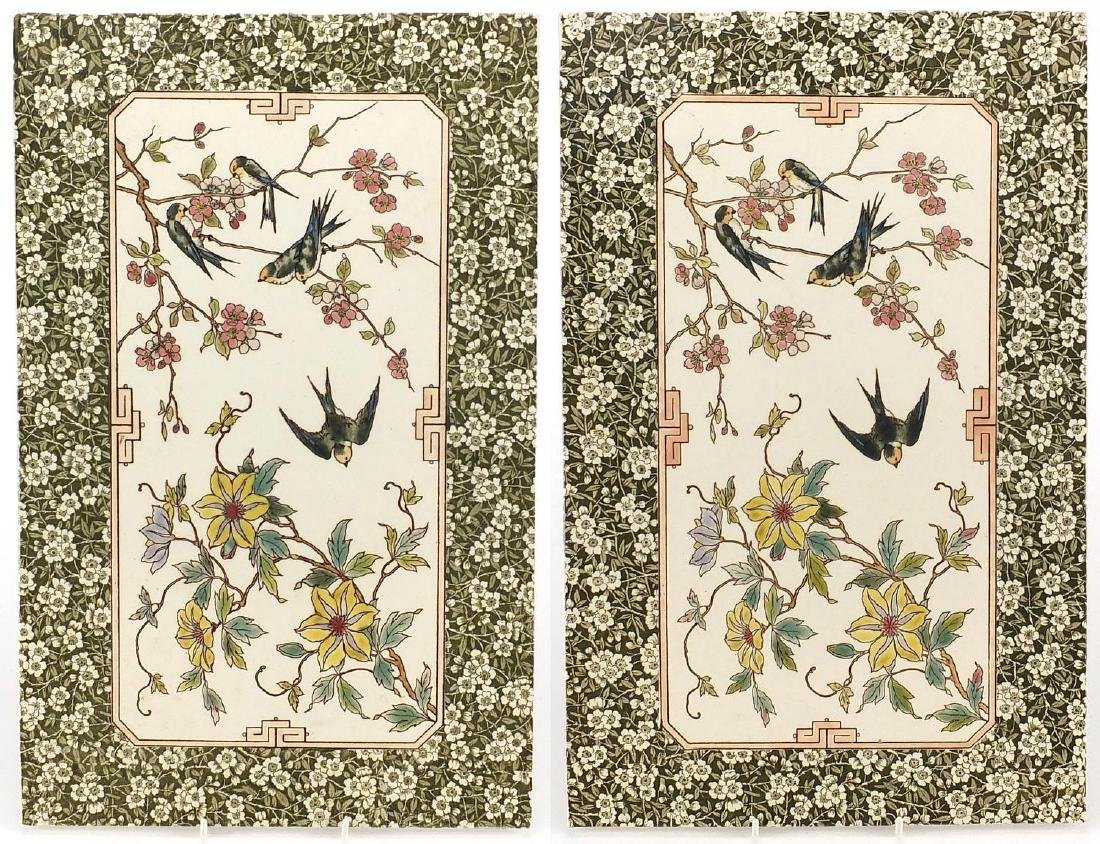 Two Aesthetic design pottery wall tiles, decorated with birds, numbered to the reverse, each 44cm