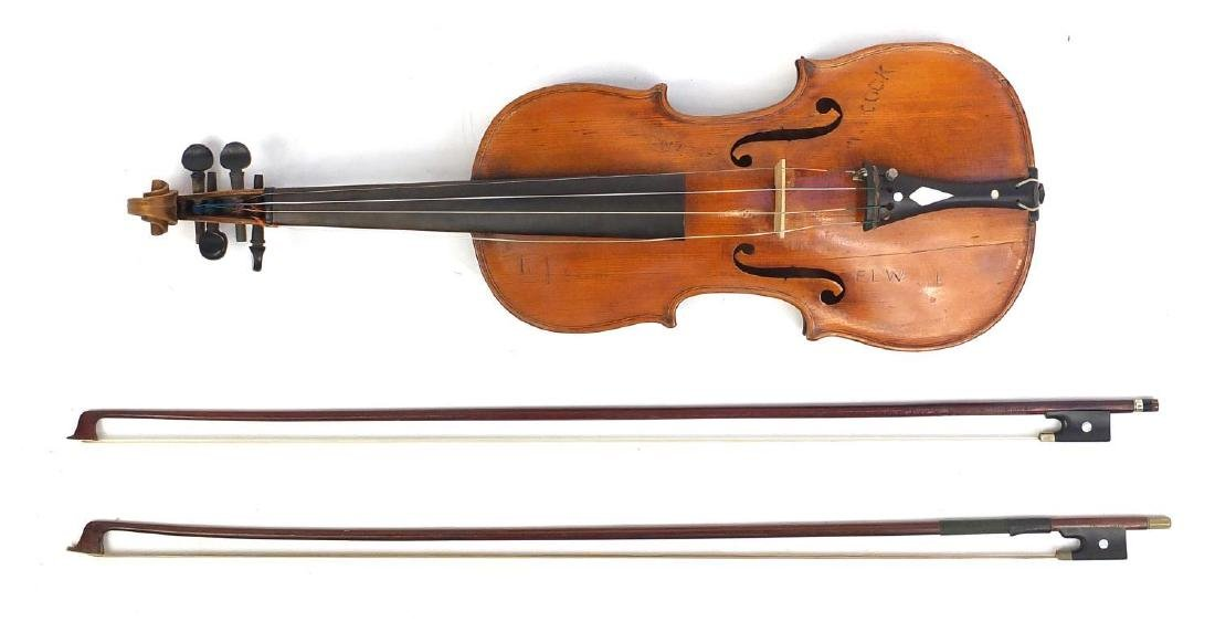 Old wooden violin with scrolled neck, one piece back, two bows and fitted wooden carrying case,