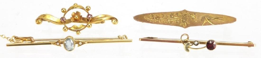 Four Victorian and later gold bar brooches, set with assorted stones including seed pearls and