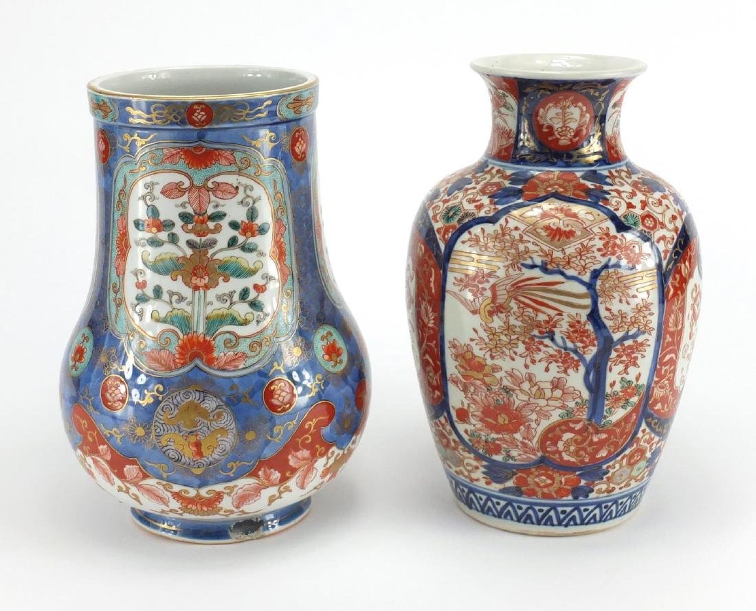 Two Japanese Imari porcelain vases including one finely hand painted and gilded with panels of