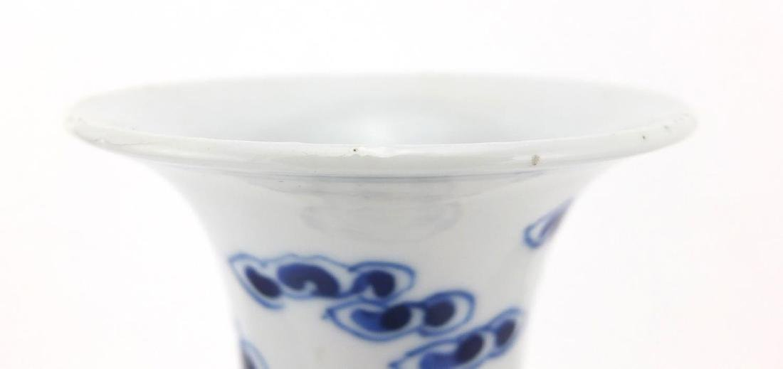Chinese blue and white porcelain baluster vase, hand painted with Qilin lions amongst clouds, 27cm