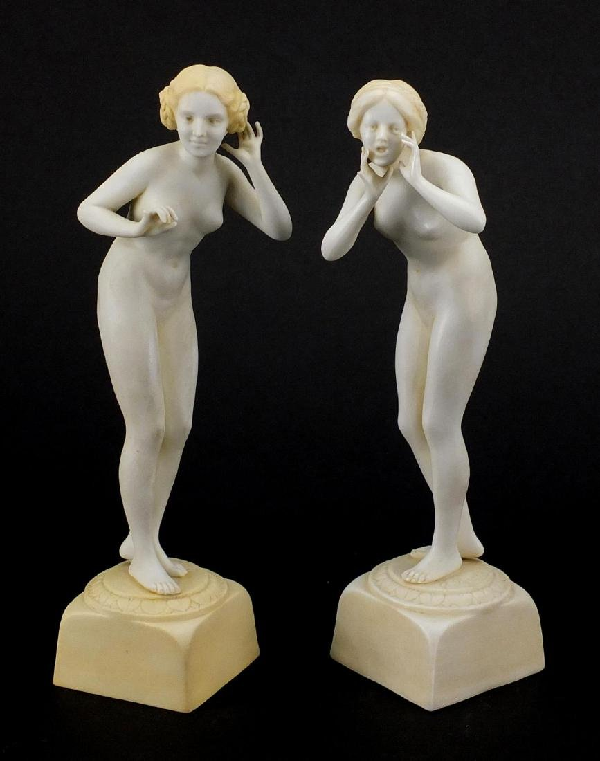 Pair of Art Deco porcelain figurines, both of nude females, numbered to the bases, each 20.5cm