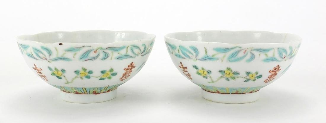 Pair of Chinese porcelain footed bowls, hand panted with flowers, six figure iron red character
