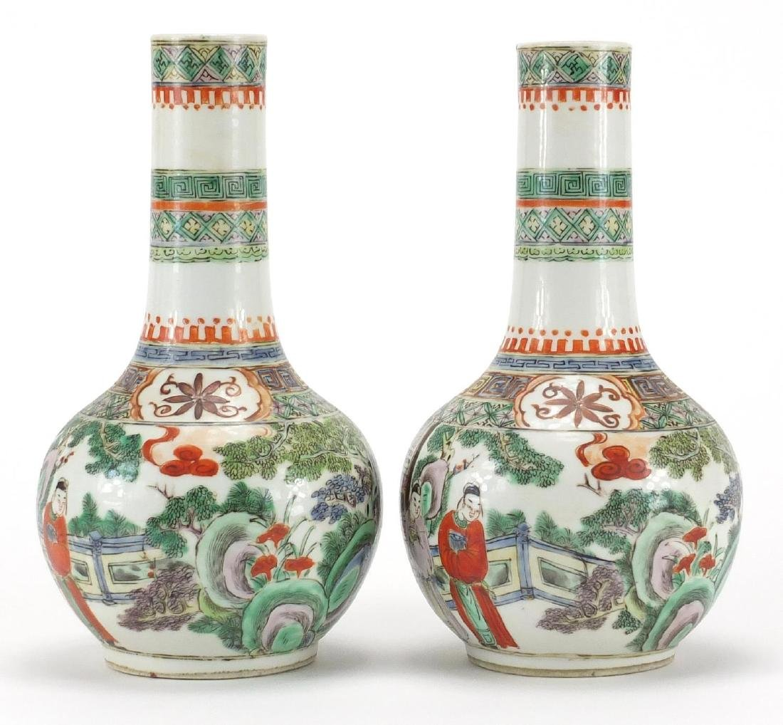 Pair of Chinese porcelain bottle vases, both hand painted in the famille verte palette with